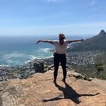 Student on mountain top looking down at Cape Town, South Africa.